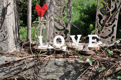 Letters spelling out the word love. Wooden letters spelling out the word love, outdoor image Royalty Free Stock Photography