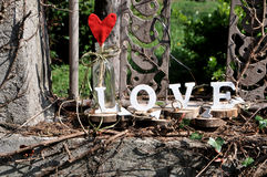 Letters spelling out the word love. Wooden letters spelling out the word love, outdoor image Royalty Free Stock Photo