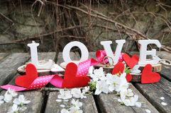 Letters spelling out the word love. Wooden letters spelling out the word love, outdoor image Stock Image