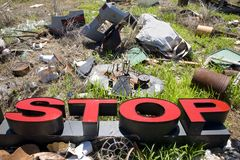 Letters spelling STOP in trashy junkyard. Stock Photography