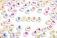 Letters spelling word books. Scattered colorful letter buttons on white background spelling word books Stock Photography