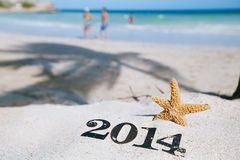 2014 letters with starfish, ocean , beach and seascape Royalty Free Stock Photos