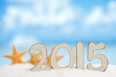2015 letters with starfish, ocean ,white sand beach Stock Image