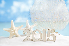 2015 letters with starfish, ocean ,white sand beach Stock Photo