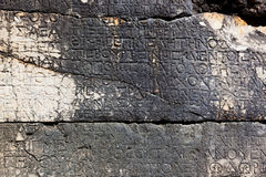 Letters on the stone in Phaselis, Turkey Royalty Free Stock Photo