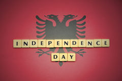 Letters with text independence day on the national flag of albania. Concept royalty free stock photography