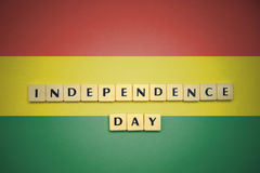 Letters with text independence day on the national flag of bolivia. Royalty Free Stock Photos