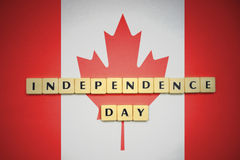 Letters with text independence day on the national flag of canada. Royalty Free Stock Photos
