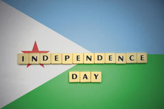 Letters with text independence day on the national flag of djibouti. Royalty Free Stock Photo