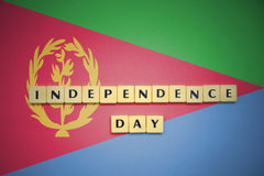 Independence day eritrea flag ribbon two fold landscape background letters with text independence day on the national flag of eritrea stock images m4hsunfo