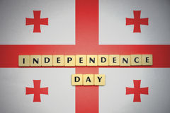 Letters with text independence day on the national flag of georgia. Concept Stock Photography