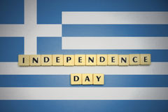 Letters with text independence day on the national flag of greece. Stock Photos