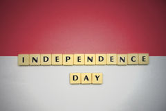Letters with text independence day on the national flag of indonesia. royalty free stock images