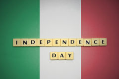 Letters with text independence day on the national flag of italy. Stock Image