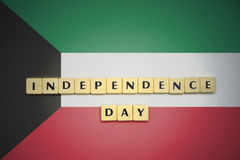 Letters with text independence day on the national flag of kuwait. Concept Royalty Free Stock Image