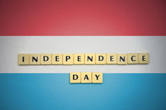 Letters with text independence day on the national flag of luxembourg . Letters with text independence day on the national flag of luxembourg. concept Royalty Free Stock Images