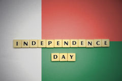 Letters with text independence day on the national flag of madagascar. Concept Stock Photo