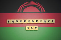 Letters with text independence day on the national flag of malawi. Royalty Free Stock Photo