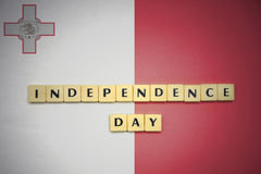 Letters with text independence day on the national flag of malta. Concept Royalty Free Stock Photos