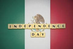 Letters with text independence day on the national flag of mexico. Concept royalty free stock photo