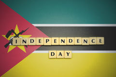 Letters with text independence day on the national flag of mozambique. Royalty Free Stock Photography
