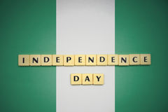 Letters with text independence day on the national flag of nigeria. Concept royalty free stock photo