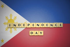 Letters with text independence day on the national flag of philippines. Royalty Free Stock Images