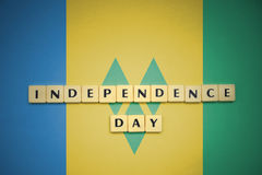 Letters with text independence day on the national flag of saint vincent and the grenadines. Concept Royalty Free Stock Images