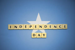 Letters with text independence day on the national flag of somalia. Concept royalty free stock photo