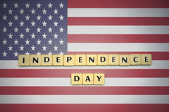 Letters with text independence day on the national flag of united states of america. Concept royalty free stock photography