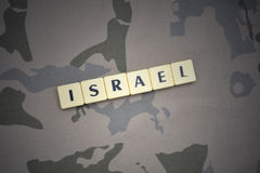 Letters with text israel on the khaki background. military concept royalty free stock photography