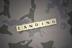 Letters with text landing on the khaki background. military concept stock images