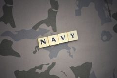 Letters with text navy on the khaki background. military concept royalty free stock images
