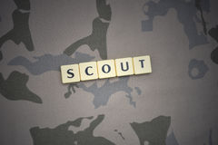 Letters with text scout on the khaki background. military concept. Letters with text scout on the khaki background texture. military concept Royalty Free Stock Images