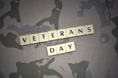 Letters with text veterans day on the khaki background. military concept royalty free stock image