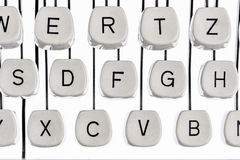 Letters on a typewriter. Keyboard letters and an old typewriter. symbolic photo for communication in former times Royalty Free Stock Image