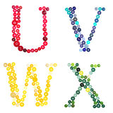 The letters U, V, W, and X made of  buttons Royalty Free Stock Images