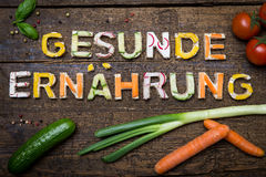Letters of vegetable canapes build the german text for healthy nutrition Stock Photo