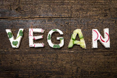 Letters of vegetable canapes builds the word Vegan Stock Photography