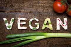 Letters of vegetable canapes builds the word Vegan Stock Images