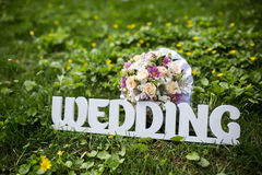 Letters WEDDING on a Green Grass Royalty Free Stock Image