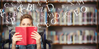 Composite image of letters on a white background. Letters on a white background against portrait of disabled schoolboy holding book in library Royalty Free Stock Images