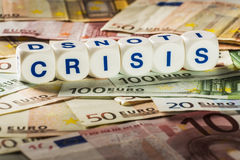 Crisis letters with banknotes Royalty Free Stock Photography