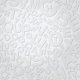 Letters on white surface Stock Photography
