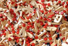 Letters in wood with Red wheels to compose words and name of chi Stock Photo