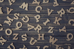 Letters on a wooden background Royalty Free Stock Photos