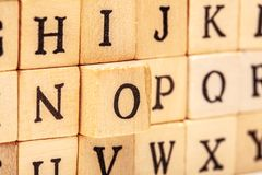 Letters on wooden cubes. Latin alphabet letters on wooden cubes font stamp typography isolated white texture stamped grunge press type stencil symbol graphic royalty free stock images