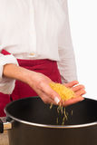 Noddles into the pot Royalty Free Stock Image