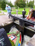 Opening the paddle on a lock gate Stock Image