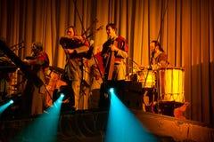 Lettische Bagpipes und Trommelmusikgruppe Auli stockfotos